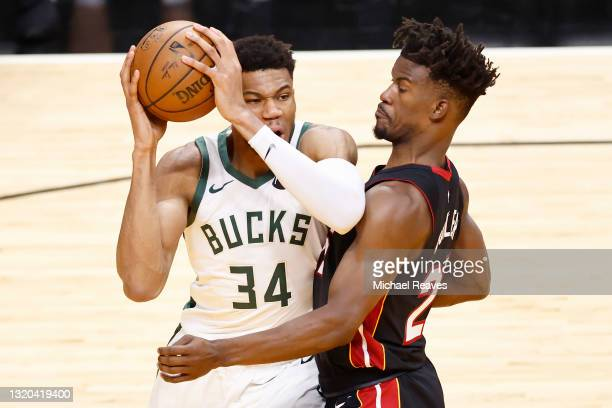 Giannis Antetokounmpo of the Milwaukee Bucks drives to the basket against Jimmy Butler of the Miami Heat during the third quarter in Game Three of...
