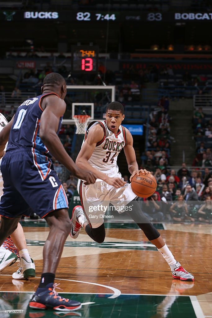 Giannis Antetokounmpo #34 of the Milwaukee Bucks drives to the basket against Bismack Biyombo #0 of the Charlotte Bobcats on March 16, 2014 at the BMO Harris Bradley Center in Milwaukee, Wisconsin.