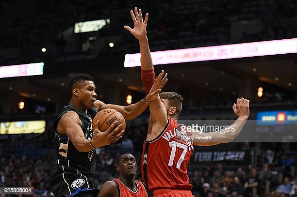 Giannis Antetokounmpo of the Milwaukee Bucks drives to the basket against Jonas Valanciunas of the Toronto Raptors during the first half of a game at...