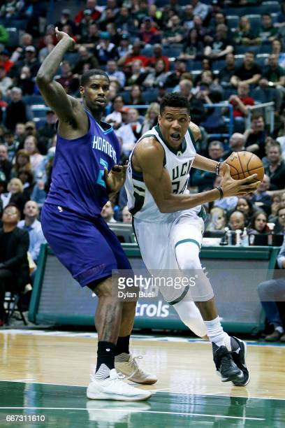 Giannis Antetokounmpo of the Milwaukee Bucks drives to the basket while being guarded by Marvin Williams of the Charlotte Hornets in the first...