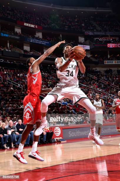 Giannis Antetokounmpo of the Milwaukee Bucks drives to the basket against the Houston Rockets on December 16 2017 at the Toyota Center in Houston...