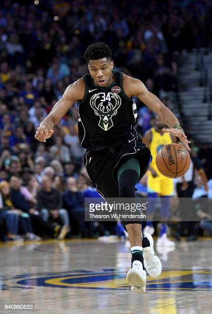 Giannis Antetokounmpo of the Milwaukee Bucks drives towards the basket against the Golden State Warriors during an NBA basketball game at ORACLE...