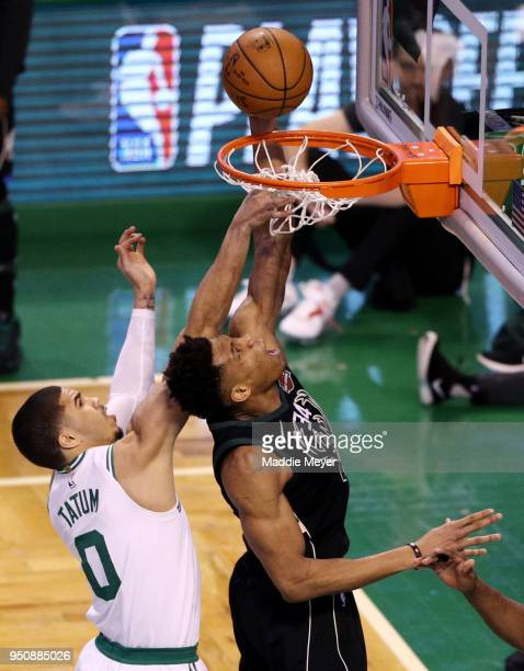 Giannis Antetokounmpo of the Milwaukee Bucks dunks against Jayson Tatum of the Boston Celtics during the first quarter of Game Five in Round One of...