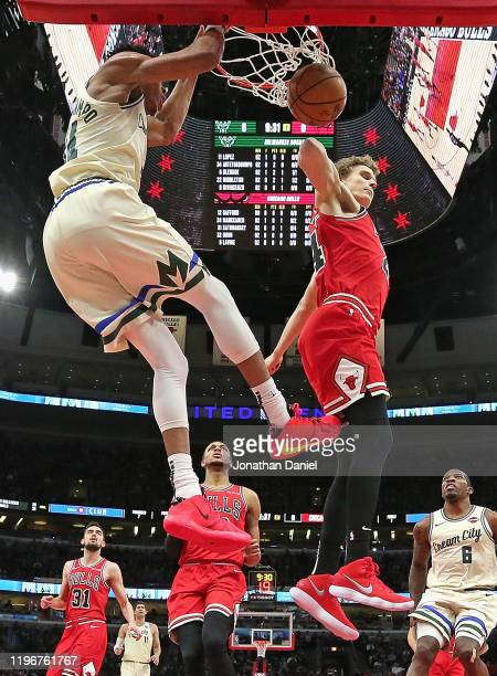 Giannis Antetokounmpo of the Milwaukee Bucks dunks against Lauri Markkanen of the Chicago Bulls at the United Center on December 30 2019 in Chicago...