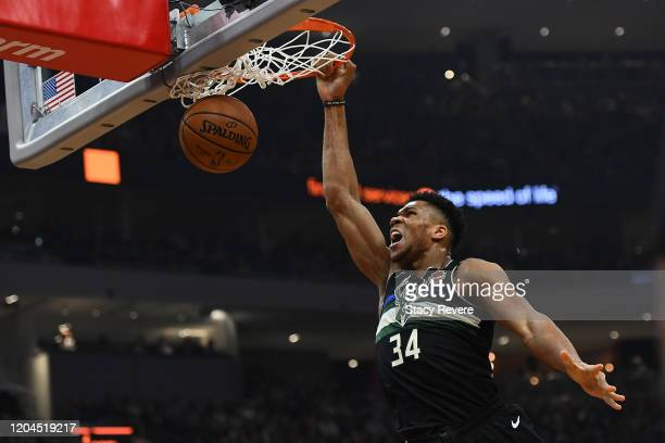 Giannis Antetokounmpo of the Milwaukee Bucks dunks against the Philadelphia 76ers during the first half of a game at Fiserv Forum on February 06 2020...