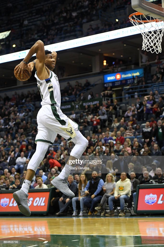 Giannis Antetokounmpo #34 of the Milwaukee Bucks dunks against the Sacramento Kings during the first half of a game at the Bradley Center on December 2, 2017 in Milwaukee, Wisconsin.