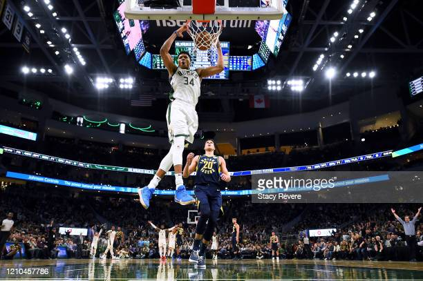 Giannis Antetokounmpo of the Milwaukee Bucks dunks against the Indiana Pacers during the second half of a game at Fiserv Forum on March 04, 2020 in...