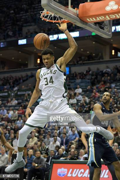 Giannis Antetokounmpo of the Milwaukee Bucks dunks against the Memphis Grizzlies during the first half of a game at the Bradley Center on November 13...