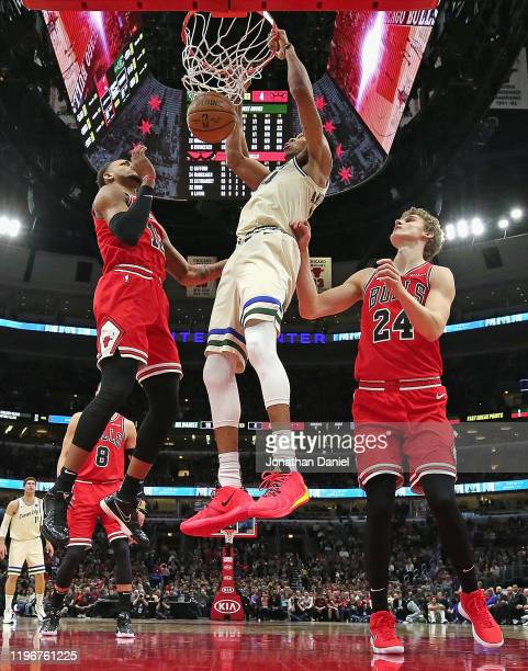 Giannis Antetokounmpo of the Milwaukee Bucks dunks between Daniel Gafford and Lauri Markkanen of the Chicago Bulls at the United Center on December...