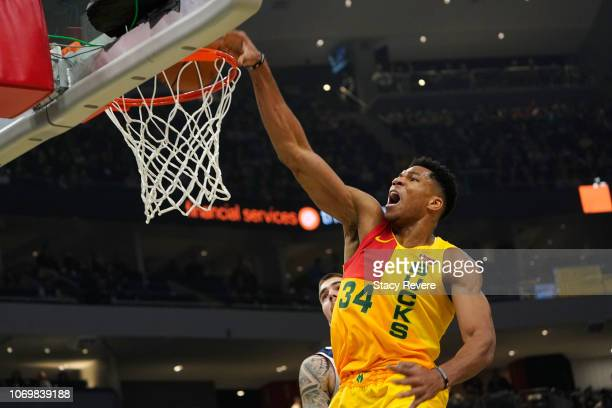 Giannis Antetokounmpo of the Milwaukee Bucks dunks during the first half of a game against the Denver Nuggets at Fiserv Forum on November 19 2018 in...