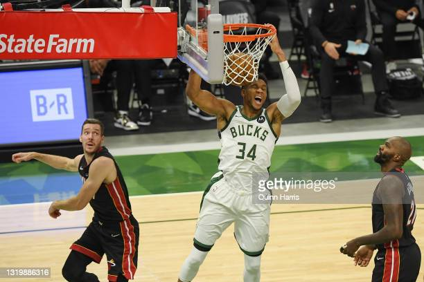 Giannis Antetokounmpo of the Milwaukee Bucks dunks in the third quarter against the Miami Heat during Game Two of their Eastern Conference...