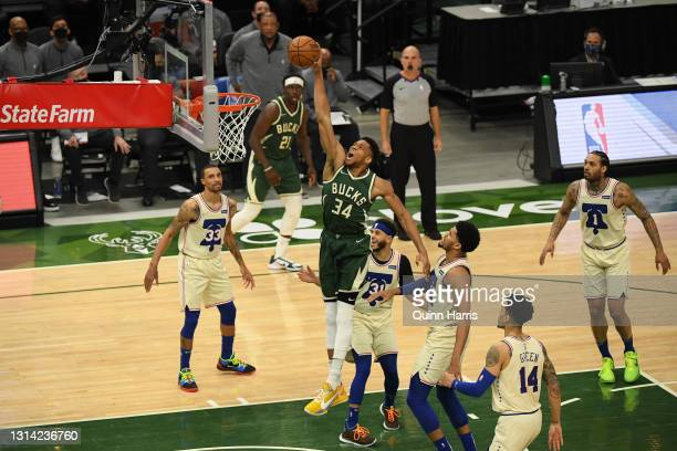 Giannis Antetokounmpo of the Milwaukee Bucks dunks in the third quarter to score 12,012 career point that became the second most points in Milwaukee...