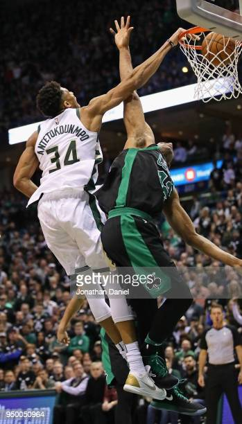 Giannis Antetokounmpo of the Milwaukee Bucks dunks over Al Horford of the Boston Celtics during Game Four of Round One of the 2018 NBA Playoffs at...
