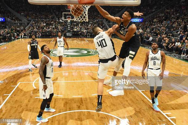 Giannis Antetokounmpo of the Milwaukee Bucks dunks over Ivica Zubac of the Los Angeles Clippers during the second half of a game at Fiserv Forum on...