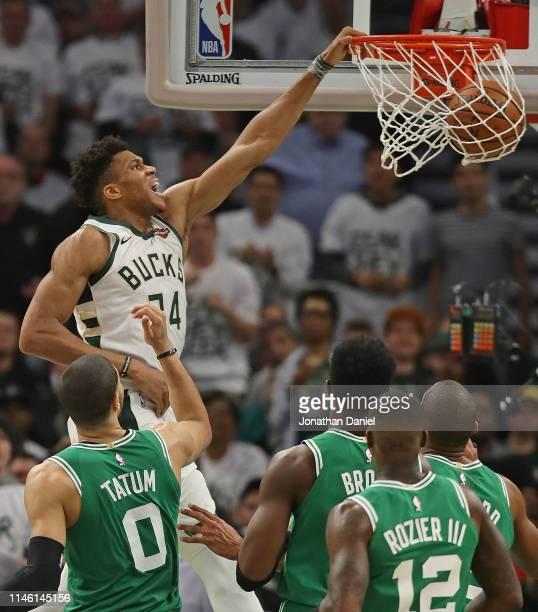 Giannis Antetokounmpo of the Milwaukee Bucks dunks over the Boston Celtics at Fiserv Forum on April 30 2019 in Milwaukee Wisconsin NOTE TO USER User...
