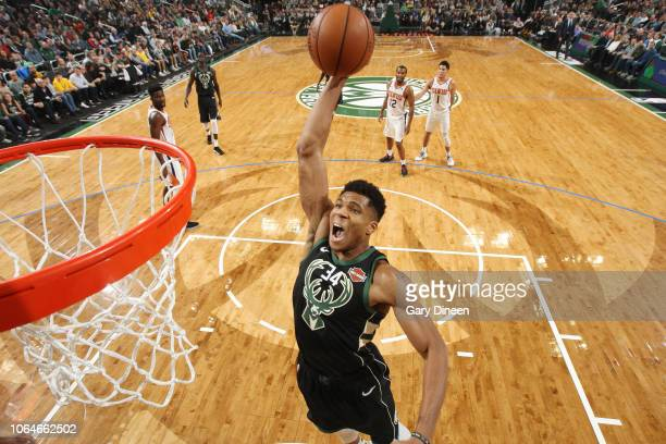 Giannis Antetokounmpo of the Milwaukee Bucks dunks the ball against the Phoenix Suns on November 23 2018 at the Fiserv Forum Center in Milwaukee...