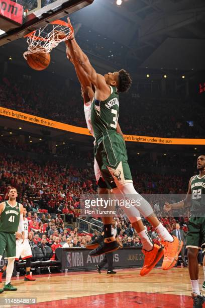 Giannis Antetokounmpo of the Milwaukee Bucks dunks the ball against the Toronto Raptors during Game Four of the Eastern Conference Finals on May 21...