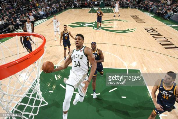 Giannis Antetokounmpo of the Milwaukee Bucks dunks the ball against the Utah Jazz on October 9 2019 at the Fiserv Forum Center in Milwaukee Wisconsin...