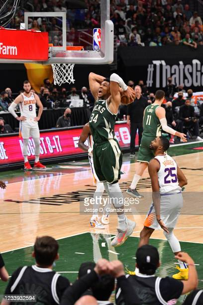 Giannis Antetokounmpo of the Milwaukee Bucks dunks the ball against the Phoenix Suns during Game Three of the 2021 NBA Finals on July 11, 2021 at...