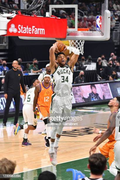 Giannis Antetokounmpo of the Milwaukee Bucks dunks the ball against the Phoenix Suns during Game Four of the 2021 NBA Finals on July 14, 2021 at...
