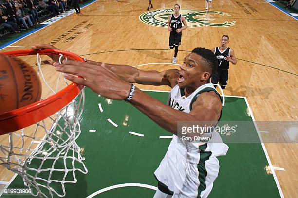 Giannis Antetokounmpo of the Milwaukee Bucks dunks the ball against the Brooklyn Nets on October 29 2016 at BMO Harris Bradley Center in Milwaukee...