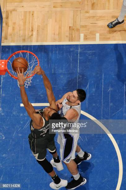 Giannis Antetokounmpo of the Milwaukee Bucks dunks the ball against the Orlando Magic on March 14 2018 at Amway Center in Orlando Florida NOTE TO...