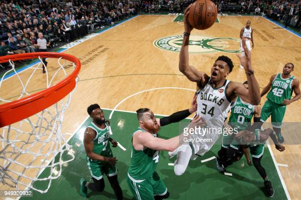 Giannis Antetokounmpo of the Milwaukee Bucks dunks the ball against the Boston Celtics in Game Three of Round One of the 2018 NBA Playoffs on April...