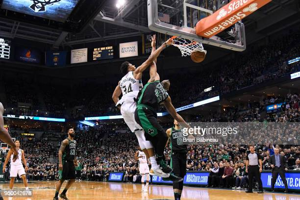 Giannis Antetokounmpo of the Milwaukee Bucks dunks the ball against Al Horford of the Boston Celtics in Game Four of Round One of the 2018 NBA...