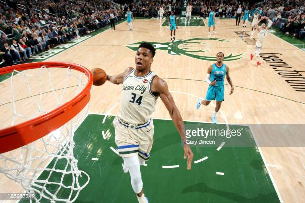 Giannis Antetokounmpo of the Milwaukee Bucks dunks the ball during a game against the Charlotte Hornets on November 30 2019 at the Fiserv Forum...