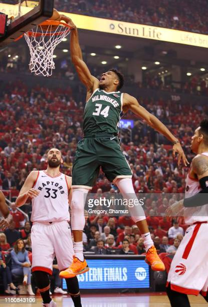 Giannis Antetokounmpo of the Milwaukee Bucks dunks the ball during the first half against the Toronto Raptors in game four of the NBA Eastern...