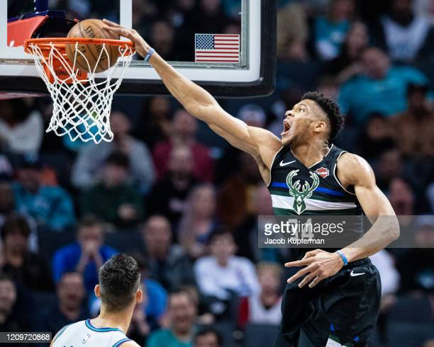 Giannis Antetokounmpo of the Milwaukee Bucks dunks the ball during the second quarter during their game against the Charlotte Hornets at Spectrum...