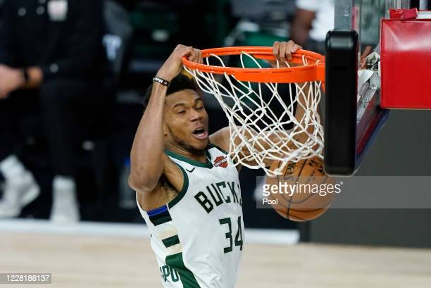 Giannis Antetokounmpo of the Milwaukee Bucks dunks the ball during the second half of an NBA basketball first round playoff game against the Orlando...