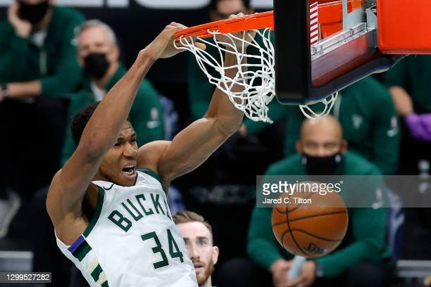 Giannis Antetokounmpo of the Milwaukee Bucks dunks the ball during the third quarter of their game against the Charlotte Hornets at Spectrum Center...