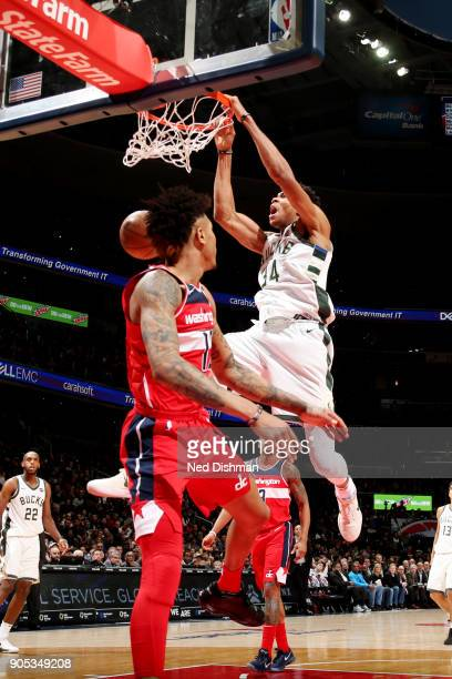 Giannis Antetokounmpo of the Milwaukee Bucks dunks the ball during the game against the Washington Wizards on January 15 2018 at Capital One Arena in...