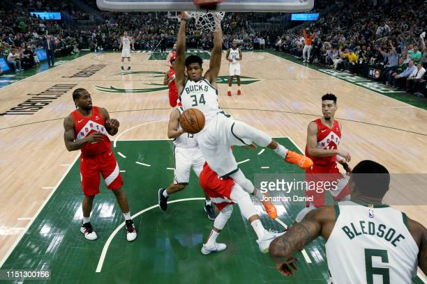 Giannis Antetokounmpo of the Milwaukee Bucks dunks the ball in the first quarter against the Toronto Raptors during Game Five of the Eastern...