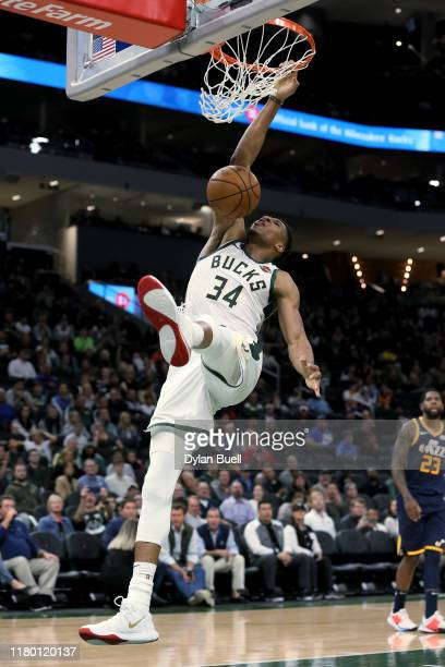 Giannis Antetokounmpo of the Milwaukee Bucks dunks the ball in the third quarter against the Utah Jazz during a preseason game at Fiserv Forum on...