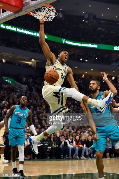 Giannis Antetokounmpo of the Milwaukee Bucks dunks the ball in the first half against the Charlotte Hornets at Fiserv Forum on November 30, 2019 in...