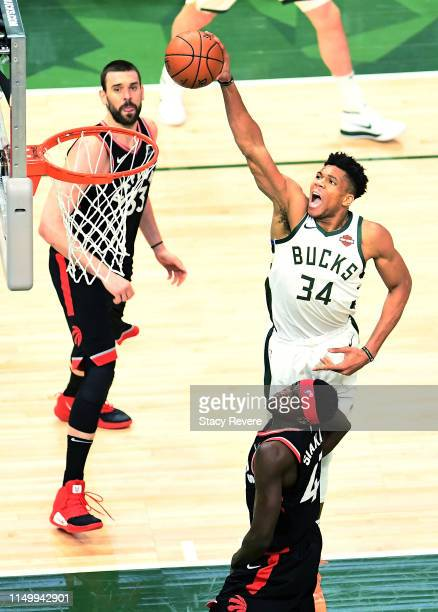Giannis Antetokounmpo of the Milwaukee Bucks dunks the ball over Pascal Siakam of the Toronto Raptors in the first quarter during Game Two of the...