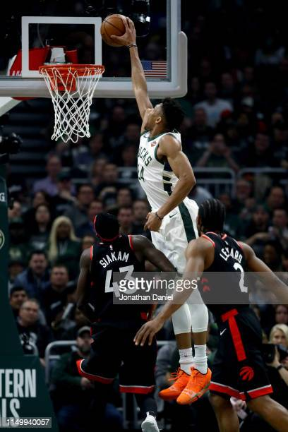Giannis Antetokounmpo of the Milwaukee Bucks dunks the ball past Pascal Siakam of the Toronto Raptors in the first quarter during Game Two of the...
