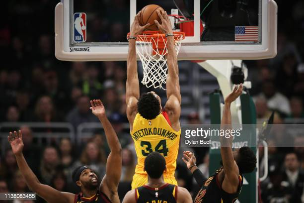 Giannis Antetokounmpo of the Milwaukee Bucks dunks the ball past David Nwaba and Tristan Thompson of the Cleveland Cavaliers in the second quarter at...