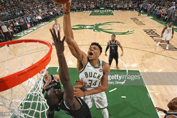 Giannis Antetokounmpo of the Milwaukee Bucks dunks the ball while guarded by Thon Maker of the Detroit Pistons during Game Two of Round One of the...