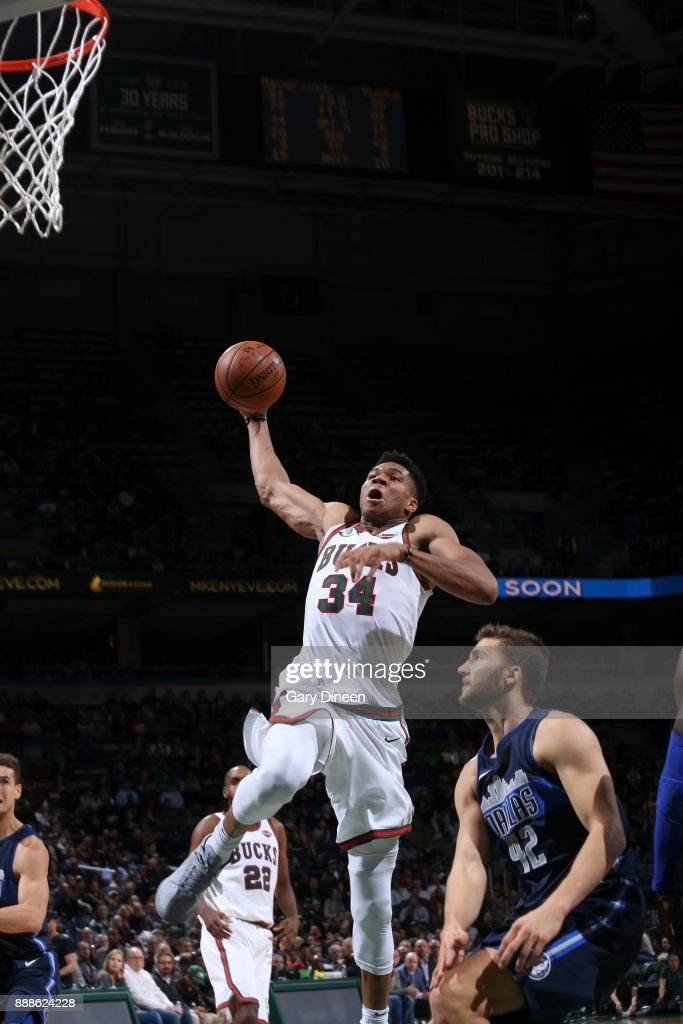 Giannis Antetokounmpo #34 of the Milwaukee Bucks elevates to dunk the ball during game against the Dallas Mavericks on December 8, 2017 at the Bradley Center in Milwaukee, Wisconsin.