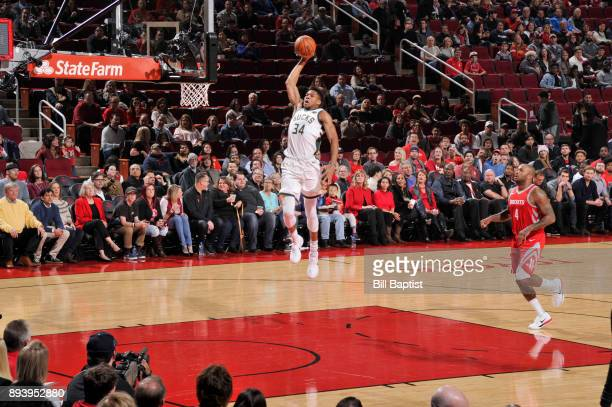 Giannis Antetokounmpo of the Milwaukee Bucks goes for a layup against the Houston Rockets on December 16 2017 at the Toyota Center in Houston Texas...