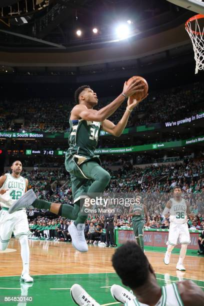 Giannis Antetokounmpo of the Milwaukee Bucks goes for the lay up during the game against the Boston Celtics on October 18 2017 at the TD Garden in...