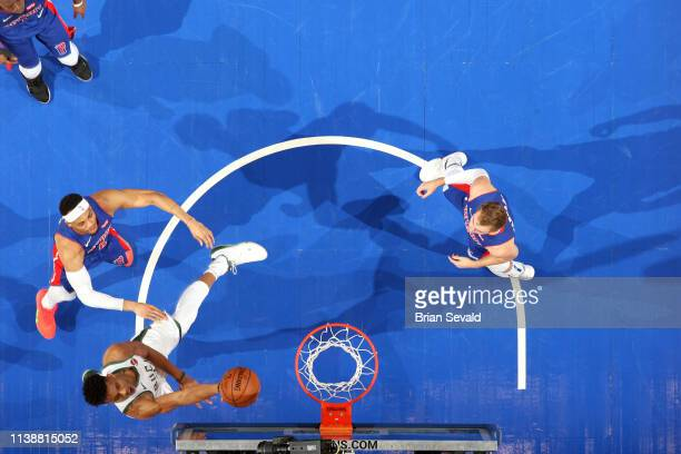 Giannis Antetokounmpo of the Milwaukee Bucks goes to the basket against the Detroit Pistons during Game Four of Round One of the 2019 NBA Playoffs on...