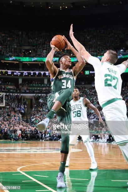 Giannis Antetokounmpo of the Milwaukee Bucks goes to the basket against the Boston Celtics on October 18 2017 at the TD Garden in Boston...