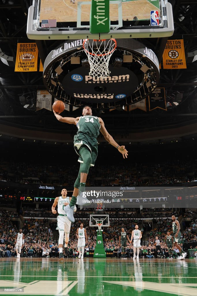 Giannis Antetokounmpo #34 of the Milwaukee Bucks goes to the basket against the Boston Celtics on December 4, 2017 at the TD Garden in Boston, Massachusetts.