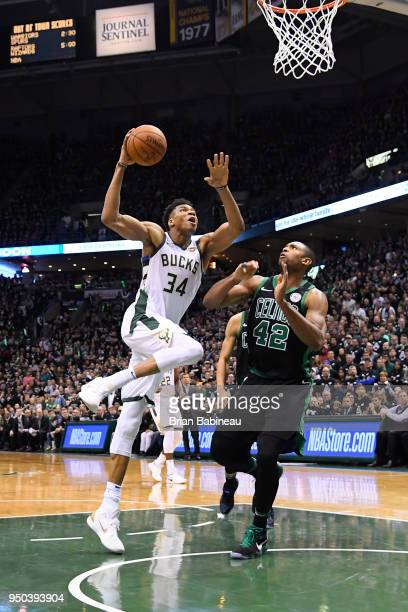 Giannis Antetokounmpo of the Milwaukee Bucks goes to the basket against the Boston Celtics in Game Four of Round One of the 2018 NBA Playoffs on...