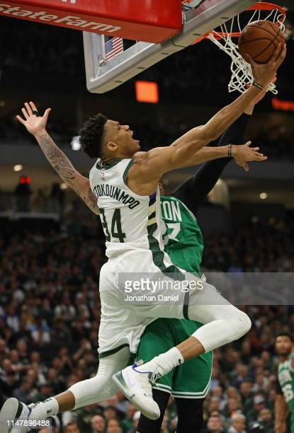 Giannis Antetokounmpo of the Milwaukee Bucks goes up against Daniel Theis of the Boston Celtics at Fiserv Forum on May 08 2019 in Milwaukee Wisconsin...
