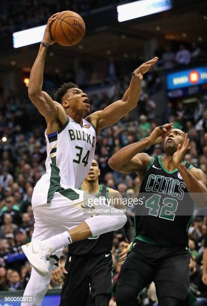 Giannis Antetokounmpo of the Milwaukee Bucks goes up for a dunk over Al Horford of the Boston Celtics during Game Four of Round One of the 2018 NBA...
